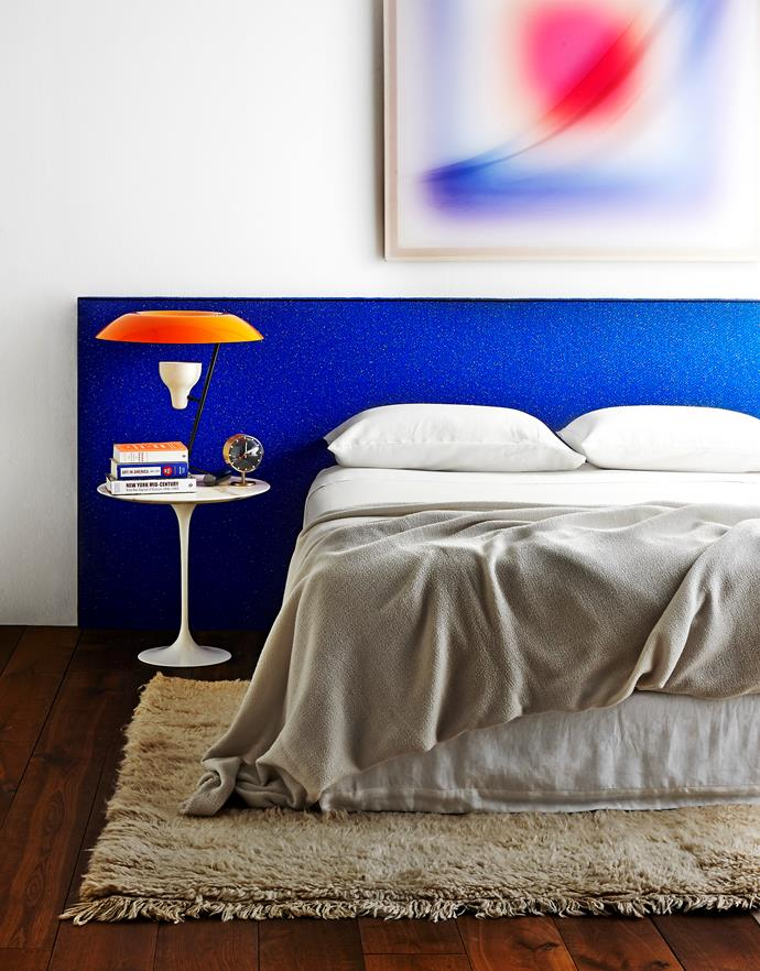 """Bright blue brings an electric pop to the neutral base palette in this bedroom.   Ralston **bedhead** from [Heatherly Design](http://www.heatherlydesign.com.au/ target=""""_blank""""), upholstered in Raf Simons for Kvadrat Pilot fabric from [Maharam](http://www.maharam.com/ target=""""_blank""""). *Hammock Painting I* **artwork** by Jonny Niesche from [Minerva](http://www.minervasydney.com/ target=""""_blank""""). KnollStudio Saarinen side **table** from [Dedece](http://www.dedece.com/ target=""""_blank""""). Flos Mod 548 **table lamp** from [Euroluce](http://www.euroluce.com.au/ target=""""_blank""""). Beni Ourain wool **rug** from [Jason Mowen](http://www.jasonmowen.com/ target=""""_blank"""")."""