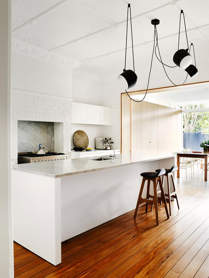 "**Room #6 by [Madeleine Blanchfield Architects](http://www.madeleineblanchfield.com/?utm_campaign=supplier/|target=""_blank"")** Existing Art Deco flourishes give this Sydney kitchen – once the living room – real character. Ornate ceiling decorations contrast with the clean lines of the modern kitchen. The fireplace alcove now houses the Ilve freestanding oven, while pale grey Carrara marble was selected for the splashback and repeated on the island benchtop. Photo: Prue Ruscoe."