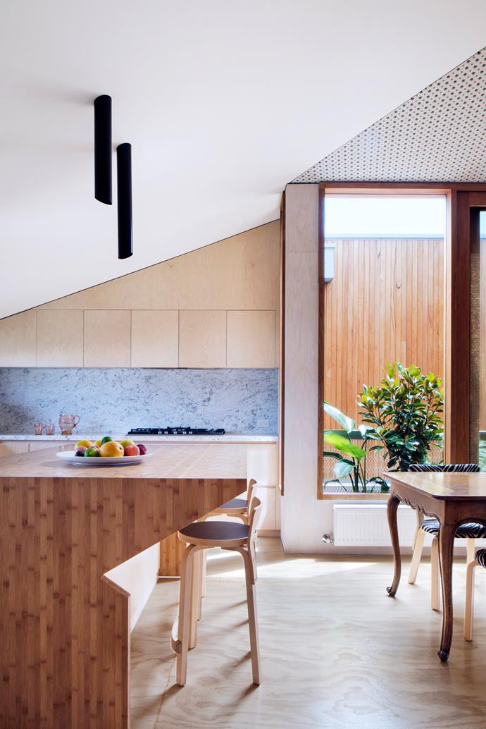 "**Room #18 by [Fiona Winzar Architects](http://www.winzar-architects.com.au/?utm_campaign=supplier/|target=""_blank"")** ""The focus was on adaptable use of space and sustainability,"" says Fiona of her transformation of this 1980s South Melbourne townhouse. This kitchen/dining/living area is part of a lightweight 'sky barn' built on top of the two-storey home. Height restrictions have been turned into a feature, with the room's sloped ceiling creating an ""intimate experience"". Photo: Richard Glover."