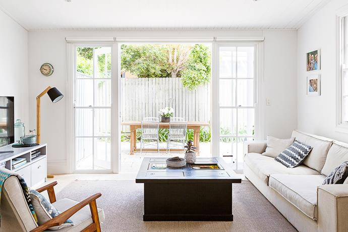 """""""The lounge is my favourite room – it gets loads of sun and is a great space to relax,"""" says Cassie. She bought the coffee table for $40 from a garage sale and refinished it herself."""