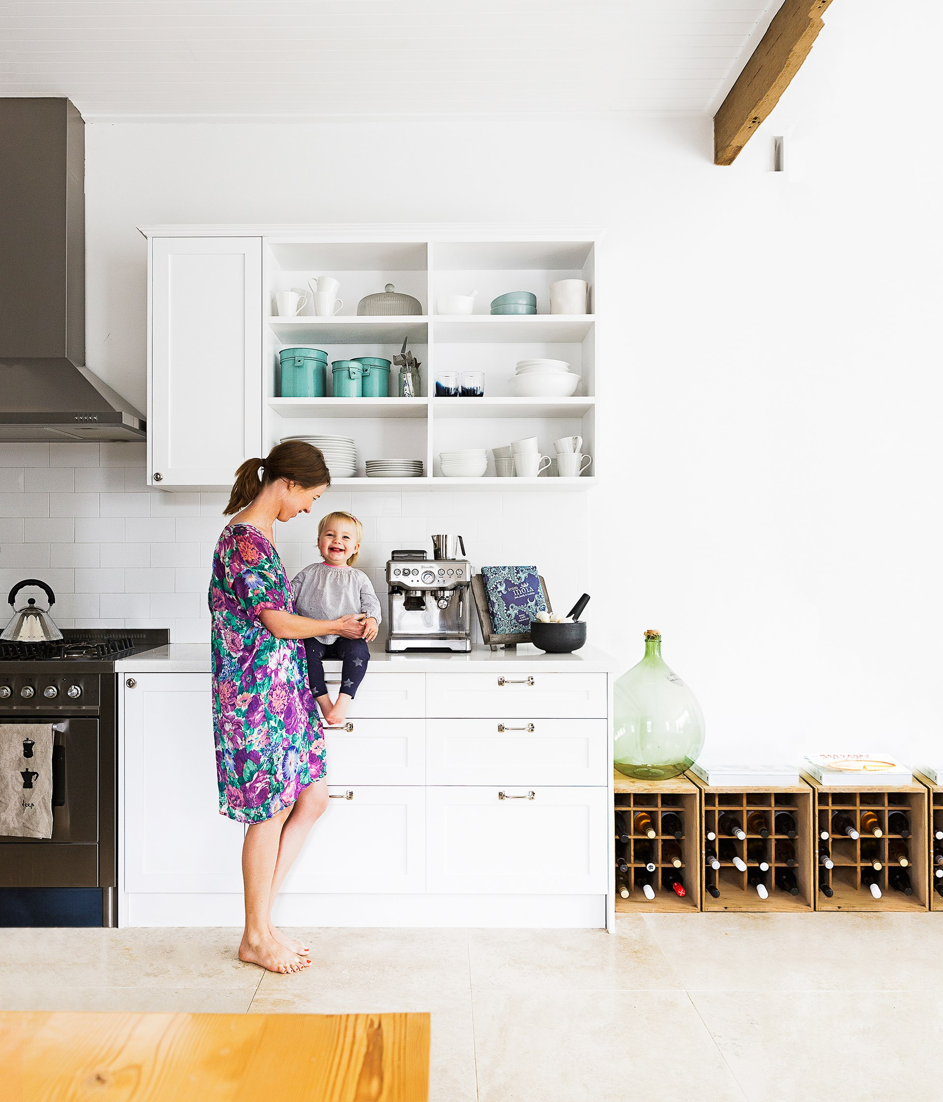 "Using teal kitchen tins and a large demijohn glass bottle, Cassie has created a vintage kitchen that delights two-year-old Maya. See more their [bright Inner West home](http://www.homestolove.com.au/cassie-and-tims-bright-inner-west-semi-2144/?utm_campaign=supplier/|target=""_blank""). Photo: Maree Homer / *homes+*"