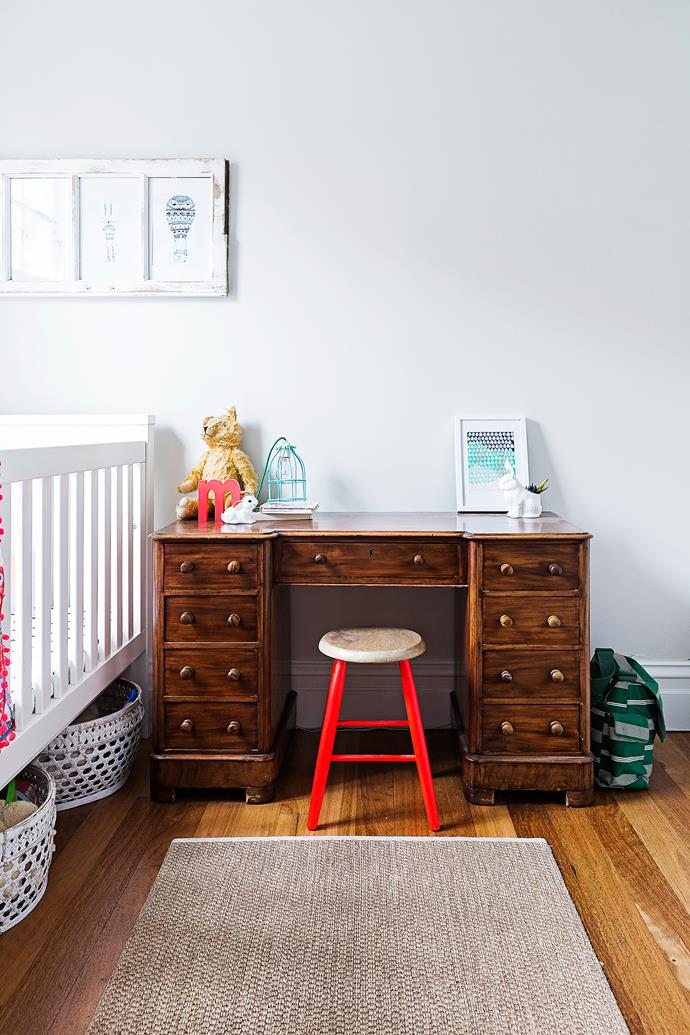 The wooden desk and stool are also revamped family heirlooms.