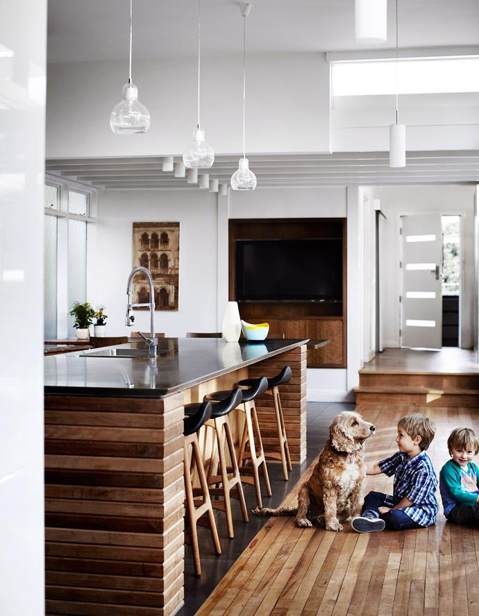 """Spock the cocker spaniel is more interested in taking in the view outside than the beautiful [joinery of his family's kitchen](http://www.homestolove.com.au/gallery-virginie-and-richards-1960s-home-renovation-1544/
