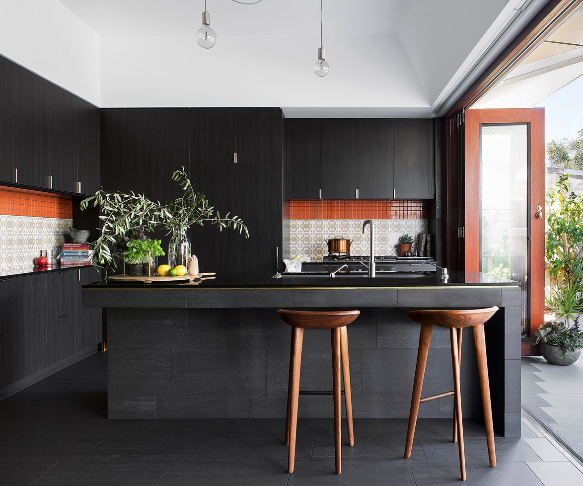 "Moody hues work miracles in this [70s inspired kitchen](http://www.homestolove.com.au/retro-refit-a-70s-inspired-kitchen-2149/|target=""_blank""), and with bi-fold doors that open to the garden, there's no danger of it feeling gloomy. *Photo: Angelita Bonetti*"
