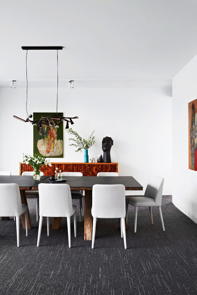 "**Room #25 by [Bower Architecture and Interiors](http://www.bowerarchitecture.com.au/?utm_campaign=supplier/|target=""_blank"")** The interiors of this Melbourne home are in harmony with its Modernist roots. The milky white walls and ceiling (painted Haymes Paint Marble Mist) are illuminated when sunshine streams in through a floor-to-ceiling window, while the custom-made pendant light, reminiscent of branches, breaks up the precision of the space. The sideboard is made from cabinet fronts salvaged from the original home. Photo: Armelle Habib"