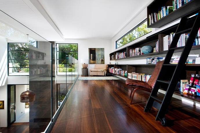 "**Room #5 by [Sofiaa Interior Design](http://www.sofiaa.com.au/|target=""_blank"")** This mezzanine-level library in Adelaide allows the owners to withdraw without being disconnected from the action in the rest of the home. Metres of open shelving and a rolling ladder, all in stained American oak, keep books within easy reach. At the far end, an oversize armchair and well-placed rug create an idyllic nook for reading. Photo: Martina Gemmola"