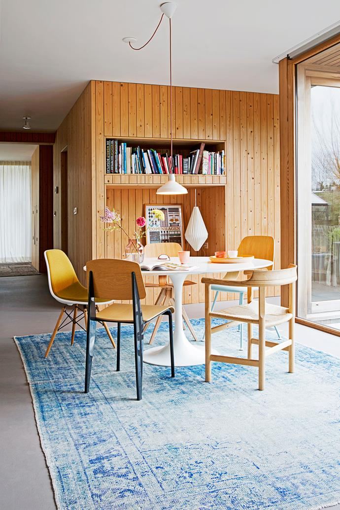 "A white dining table and metal elements, such as the chair legs, balance out the untreated pine panelled walls of this [beautiful bungalow](http://www.homestolove.com.au/gallery-christiens-simply-beautiful-dutch-bungalow-2172|target=""_blank""). *Photo: Jeltje Janmaat/House of Pictures*"