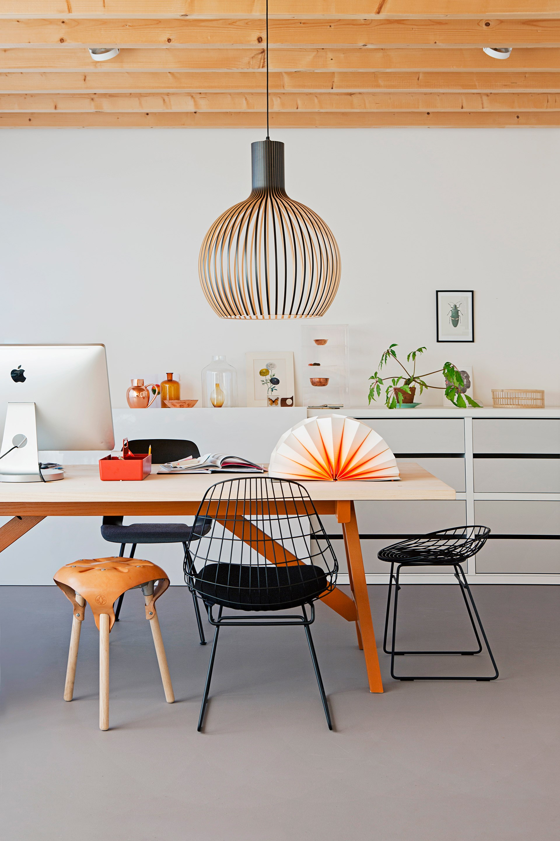 "Thin strips of timber moulded into a bulbous shape form a beautifully sculptural light that makes a grand addition to this office space. Take a look around this [furniture designer's Dutch bungalow](http://www.homestolove.com.au/gallery-christiens-simply-beautiful-dutch-bungalow-2172|target=""_blank""). Photo: Jeltje Janmaat @ House of Pictures / *real living*"