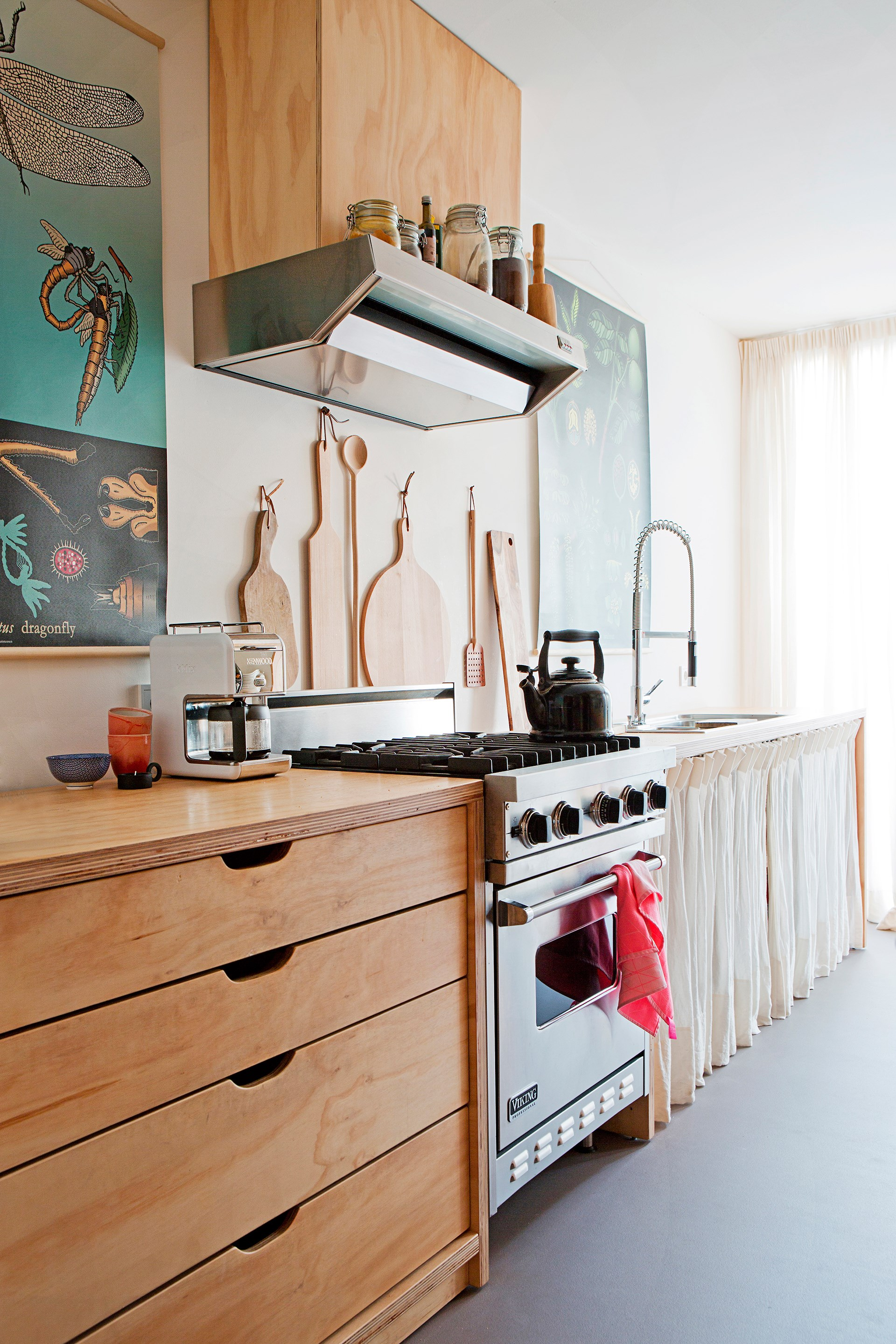"The straight-line kitchen in this [Scandinavian bungalow](http://www.homestolove.com.au/gallery-christiens-simply-beautiful-dutch-bungalow-2172) embraces simplicity with its raw timber cabinetry and curtains hung the ""old-fashioned way""."
