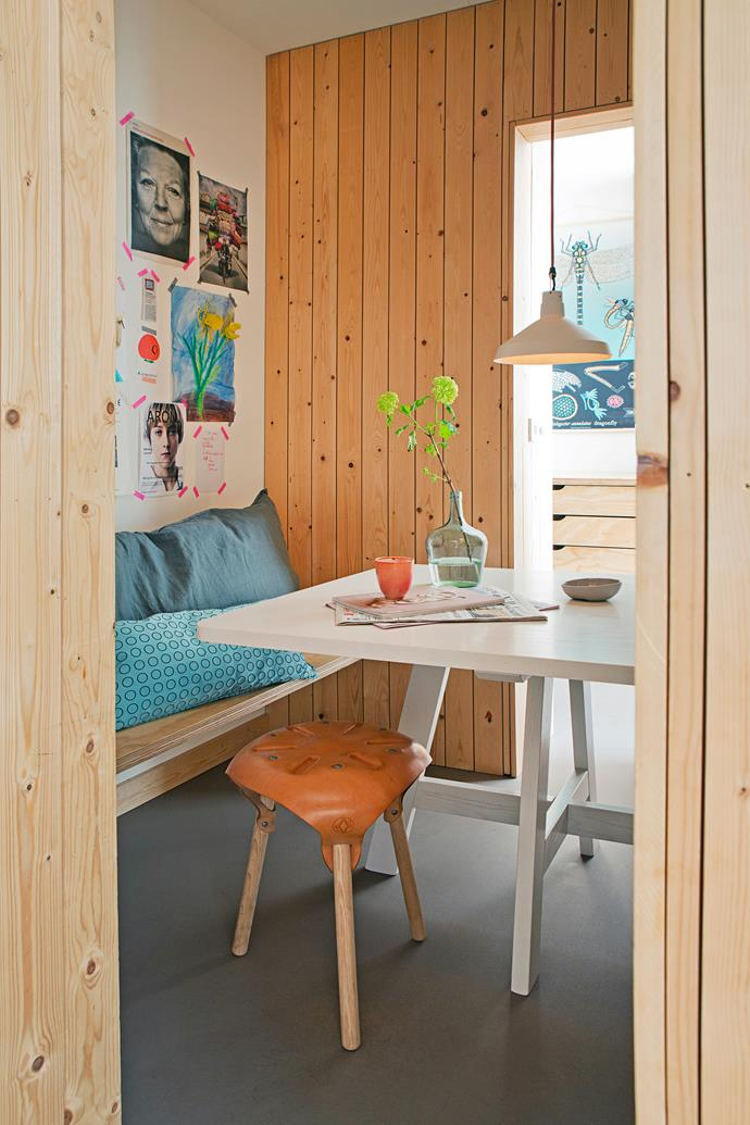 The 'train compartment' serves as a dining room. With its built-in benches and custom-made table, it's the favourite room in the house.