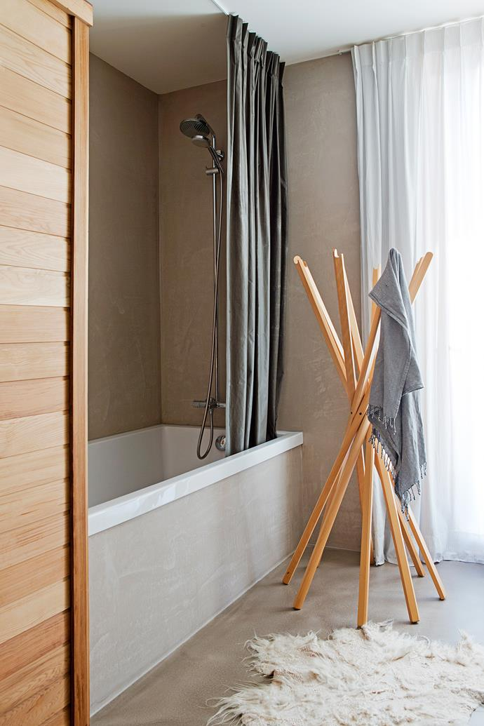 """The bathroom has been plastered with tadelakt, a traditional, lime-based Moroccan plaster. The Sciangai clothing stand, perfect for towels, is from [Space](http://www.spacefurniture.com.au/?utm_campaign=supplier/ target=""""_blank"""")."""