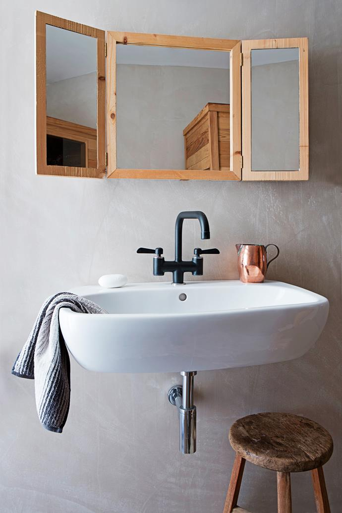 """The timber-framed mirror and rustic stool combine with the timber clothing rack to enhance the bathroom's natural feel. The black tap is from [Ikea](http://www.ikea.com/?utm_campaign=supplier/ target=""""_blank"""")."""