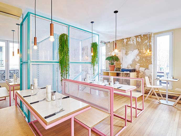 Diner booths and Miami's colourful beach huts inspired furniture and palette, with turquoise and pink steel tubular structures inhabiting the place.