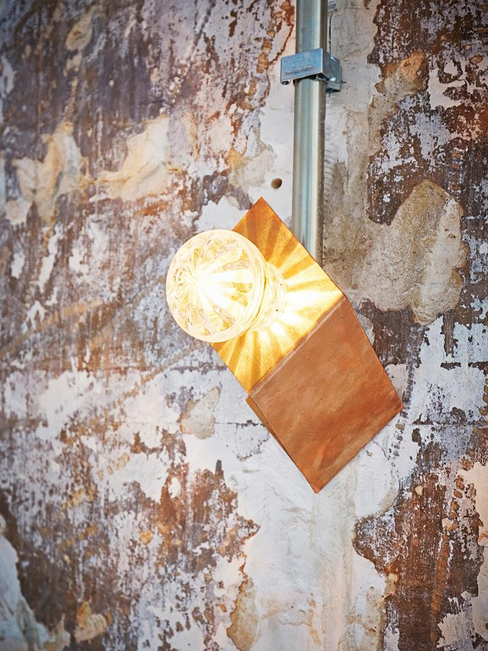 Lighting is an important component in the PNY burger restaurants; the wall fixtures and pendant lights in PNY Marais were custom-made with vintage-style light bulbs and copper.