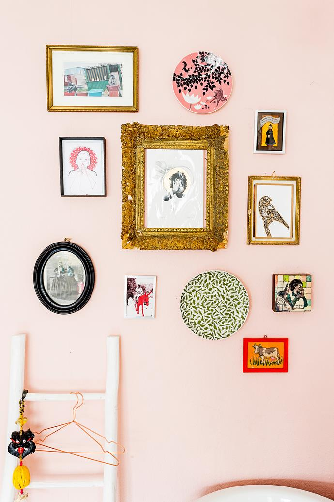 """A gold gilt frame is the star of this feature wall. Homeowner Menne also mixed things up by including decorative wall plates as part of his [eclectic home](http://www.homestolove.com.au/mennes-budget-city-apartment-makeover-2198/?utm_campaign=supplier/