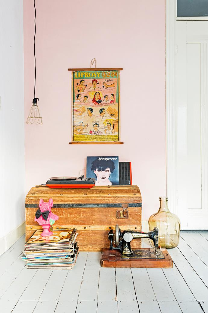 Eclectic pieces come together to create an art installation, while an old leprosy poster features Menne's favourite interior colours - coppery green and soft pink.