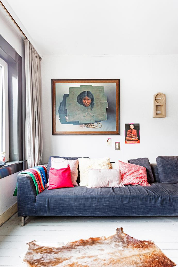"Menne bought the large oil painting above the living room sofa in Bolivia. ""Everything was incredibly cheap, which made me greedy,"" he says."