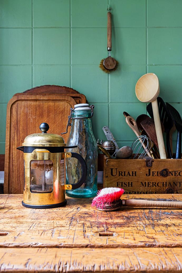This wooden kitchen utensil box was used for storing oysters back in the day.