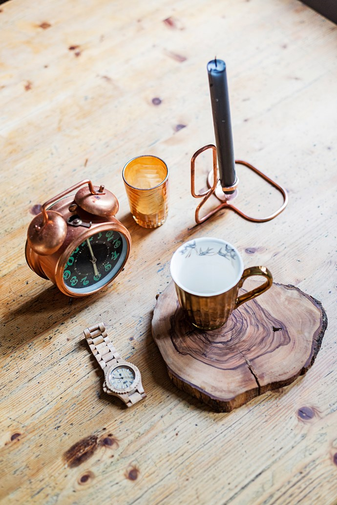 """""""When I have visitors, the favourite place to gather is definitely the kitchen table,"""" Menne says. The [Hay](http://www.hay.dk /?utm_campaign=supplier / target=""""_blank"""") copper candleholder was a Christmas present; a sliced tree trunk acts as a decorative and functional coaster."""