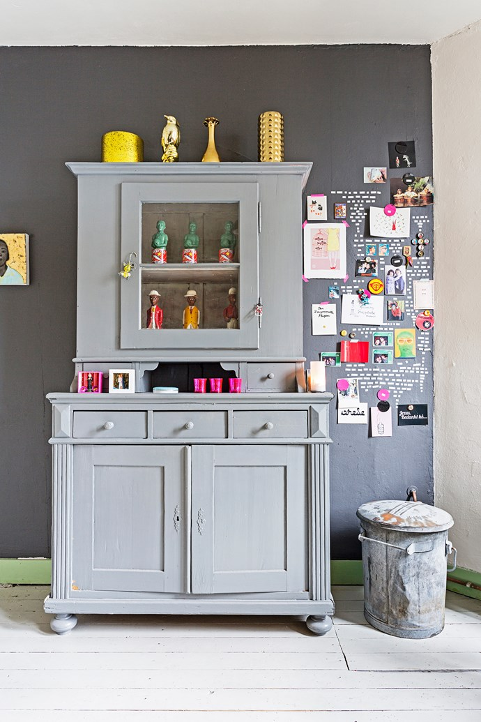 The hallway cabinet was a gift from Menne's mother – he painted it grey and filled it with oddities, including dolls from South Africa.