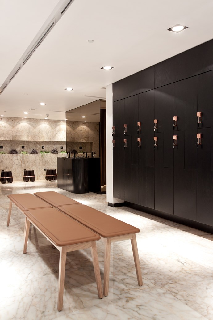 **The Yoga Center** Inspired by the local environment, the architects opted for an earthy palette specifying Turkish marble flooring, tan leather, copper fittings, dark timber joinery and sepia-toned mirrors. Photo: Rashed Alfoudari.
