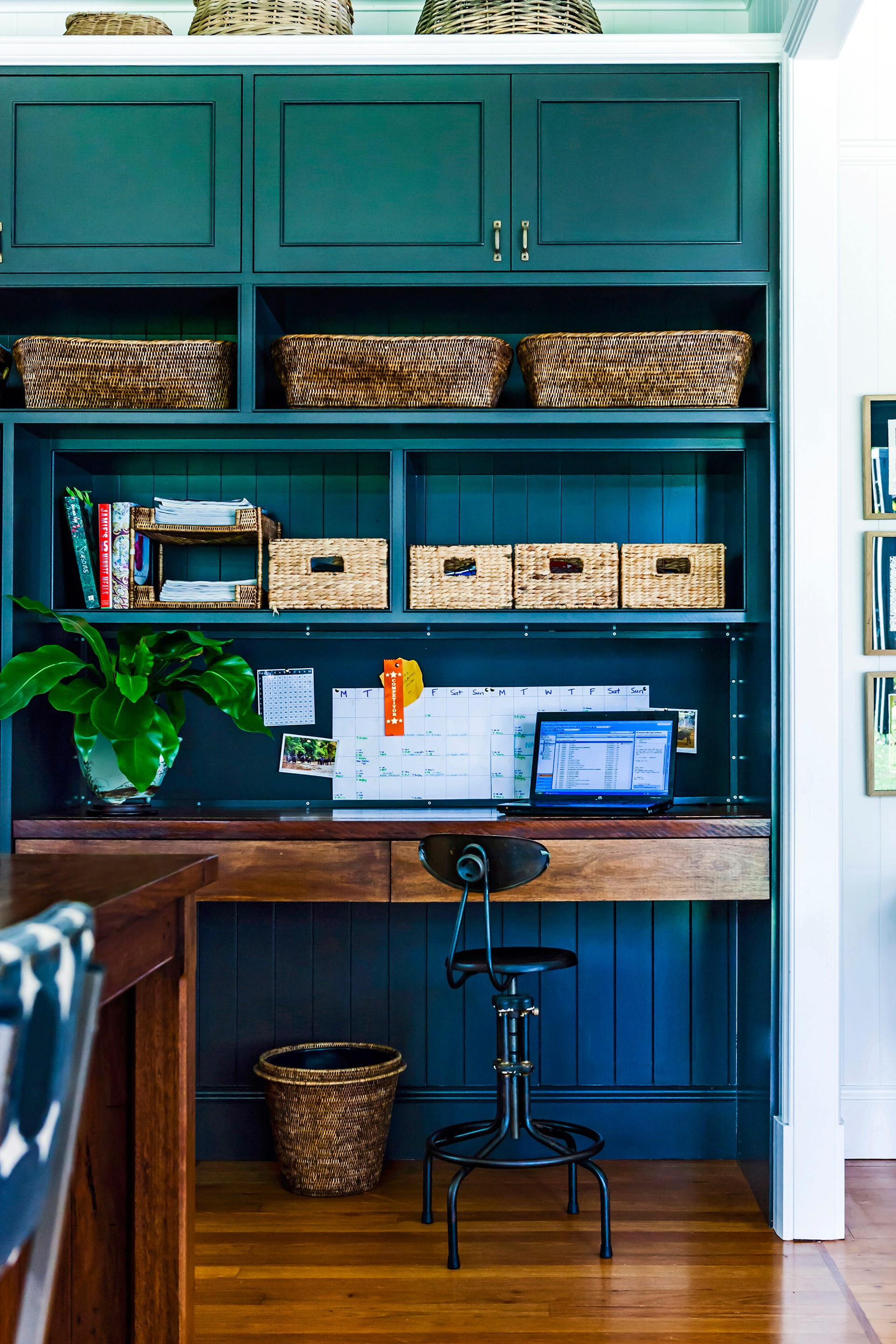"""Woven storage baskets keep paperwork organised in this [busy family home](http://www.homestolove.com.au/gallery-bettina-and-davids-renovated-queenslander-2224