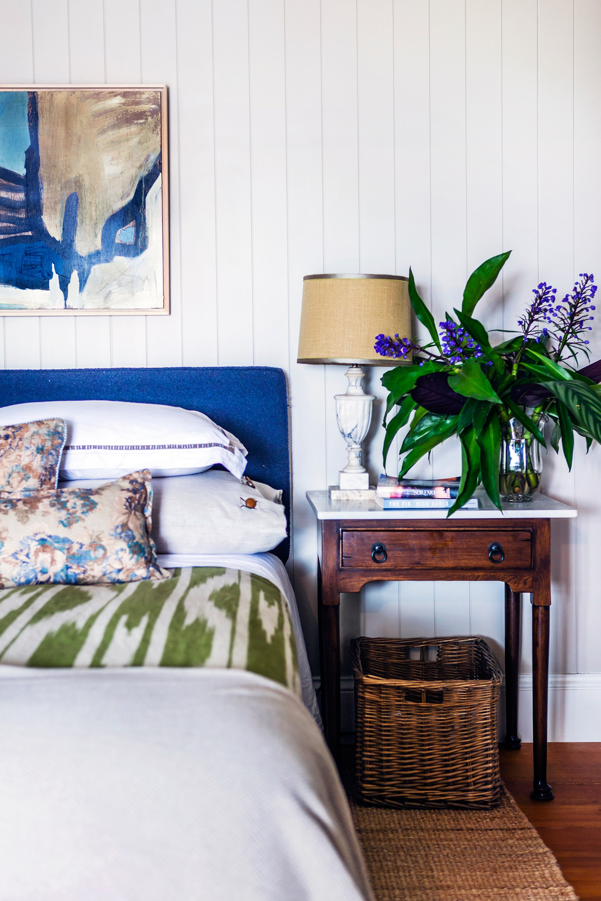 """A stylish wicker baskets fits tidily under the bedside table in the main bedroom is this [beautiful Queenslander](http://www.homestolove.com.au/gallery-bettina-and-david-s-renovated-queenslander-2224