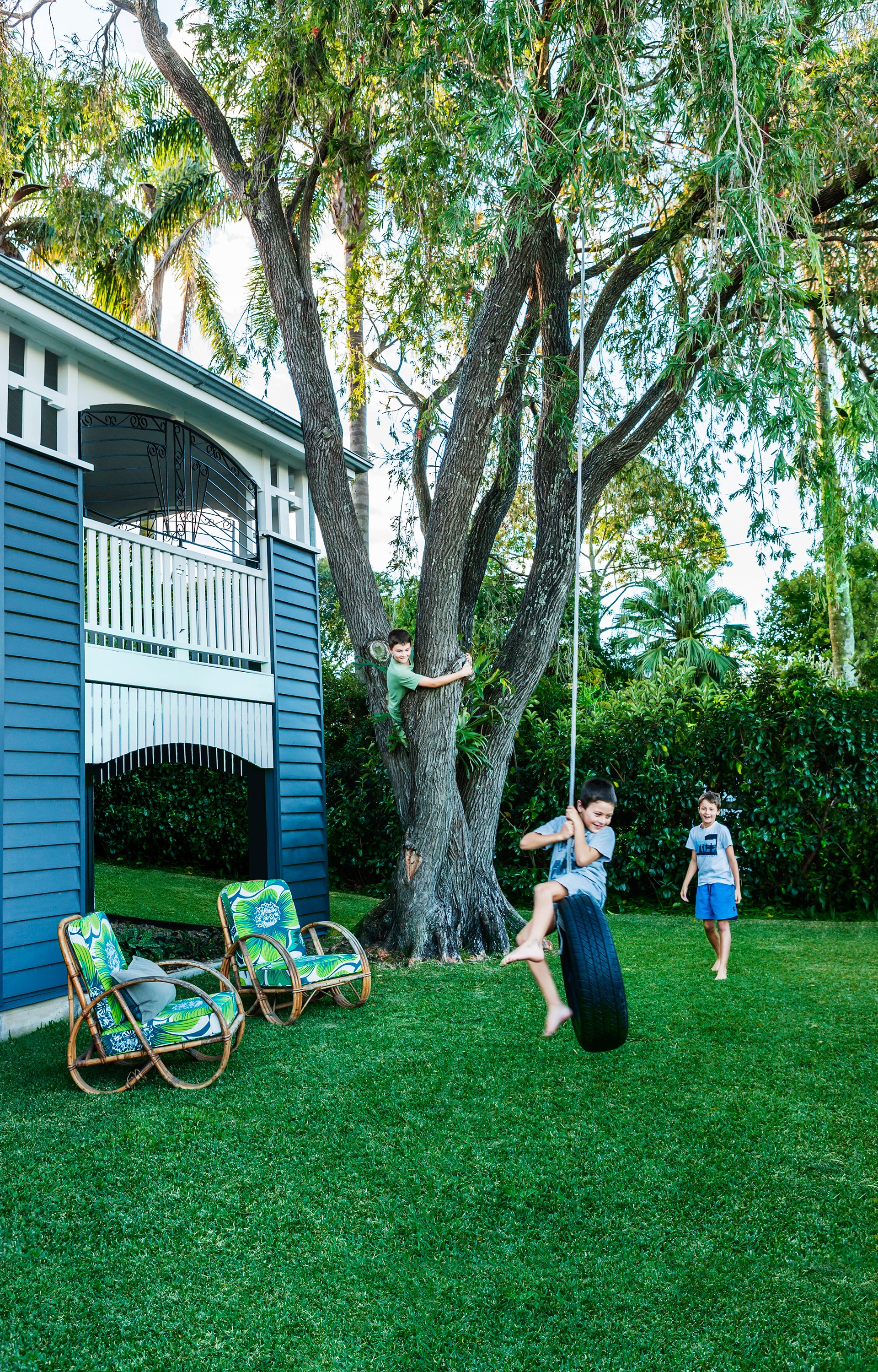 "Brothers Tom, Ned and James (from left) make the most of their spacious garden and tire swing. Take the tough of this [renovated country-style Queenslander](http://www.homestolove.com.au/gallery-bettina-and-davids-renovated-queenslander-2224/?utm_campaign=supplier/|target=""_blank""). Photo: Maree Homer / *Australian House & Garden*"