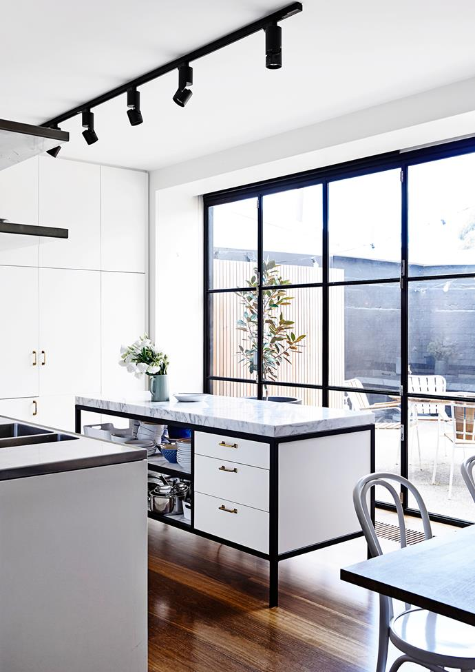 """**Industrial arts –** with its classic colour palette and sturdy metallic bones, this Melbourne kitchen, in a renovated 150-year-old property that was once a pub, nails the elegant industrial aesthetic. Karen Alcock of [MA Architects](http://www.maarchitects.com.au/?utm_campaign=supplier/