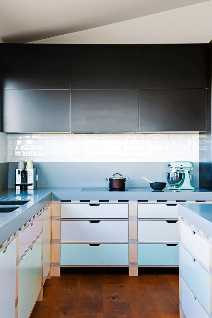 """**Colour coding –** subtle pastels distinguish the two-pac polyurethane drawer fronts of this kitchen in a holiday house on the NSW South Coast. The owners asked for a welcoming, relaxed space, so designer Darren Genner of [Minosa](http://www.minosadesign.com/?utm_campaign=supplier/