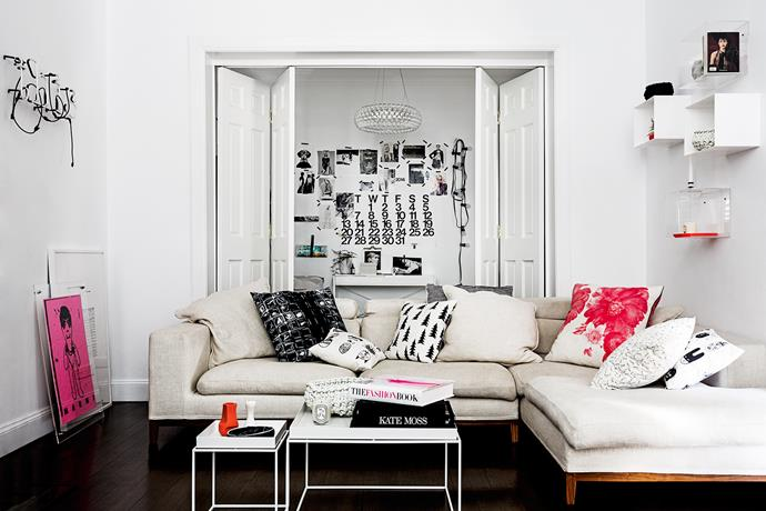 Black and white with neon pops mix with designer pieces and quirky finds, creating a smart and edgy family home. The neon pink accents encourage the eye to dart around the living room.