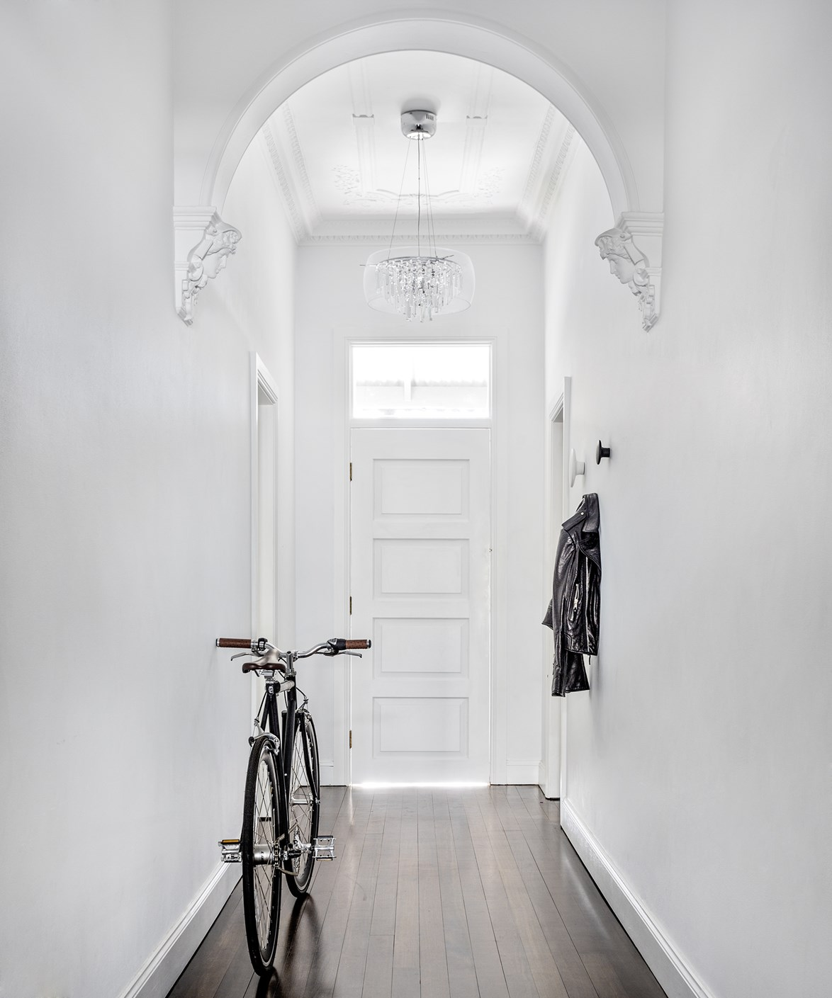 "Although an all-white interior and Scandinavian style decor has have given this [Sydney home](https://www.homestolove.com.au/gallery-renata-and-michaels-scandinavian-style-cottage-2239|target=""_blank"") a minimalist look, its ornate architectural features mean it also retains much of its original Victorian charm. *Photo:* Felix Forest"