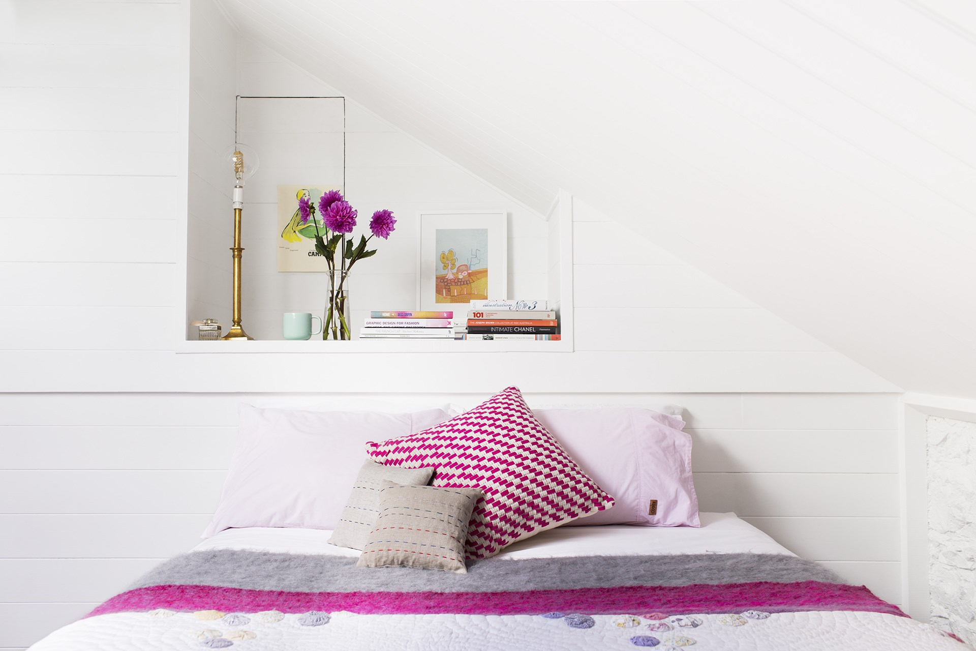 """Pretty pops of pink look sweet against the serene white backdrop of this [light-filled Melbourne terrace](http://www.homestolove.com.au/gallery-georgias-light-filled-melbourne-terrace-2242
