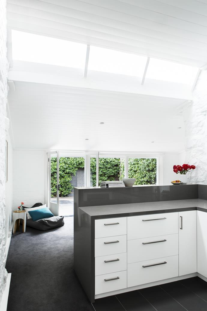 Light pours through the glass skylights in the open-plan kitchen and living area.