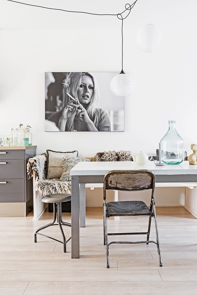 The dining area combines all of Marieke's fave things: soft tones, industrial pieces and woolly textures. A bench seat is a nice alternative to chairs. The photo is of Brigitte Bardot.