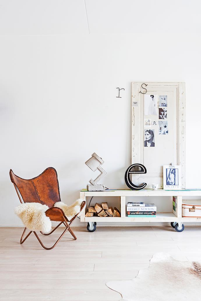 """A melange of textures – natural timbers, worn leather and animal skins – soften the white room. The lamp is made by [Victor Vetterlein](http://www.victorvetterlein.com/?utm_campaign=supplier/ target=""""_blank"""") out of recycled egg cartons."""