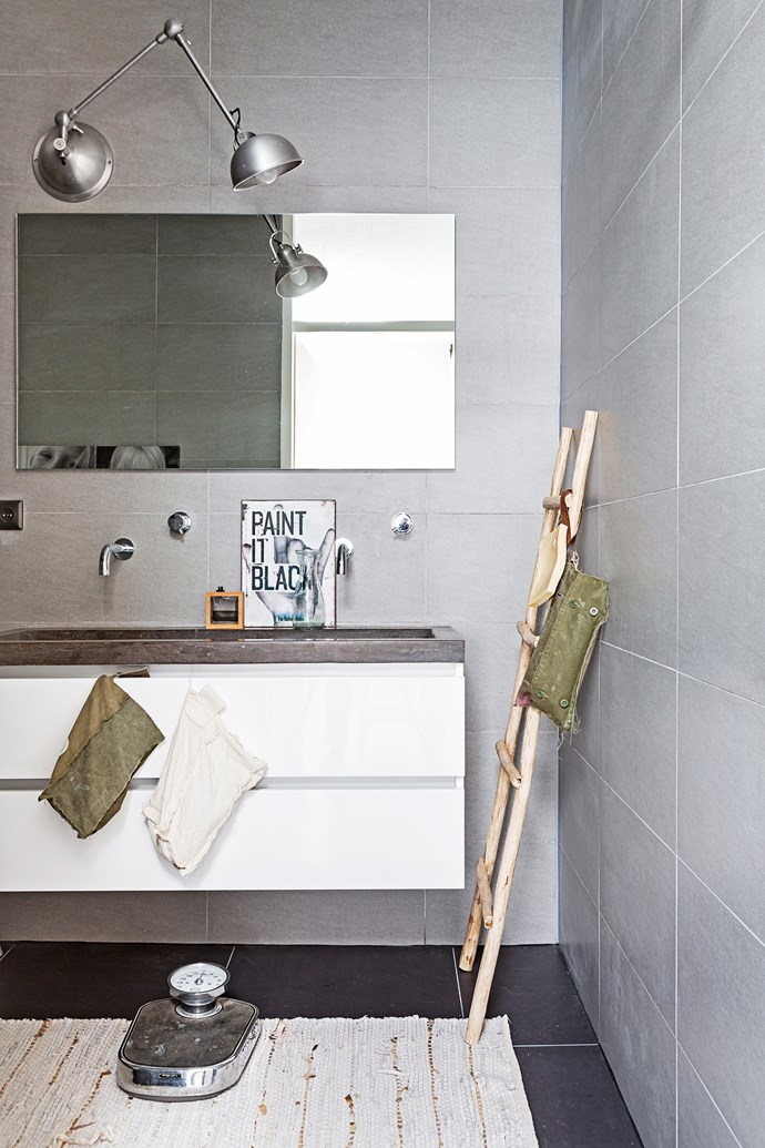 The bathroom features a darker colour palette than the rest of the house, creating a cosy sanctuary.