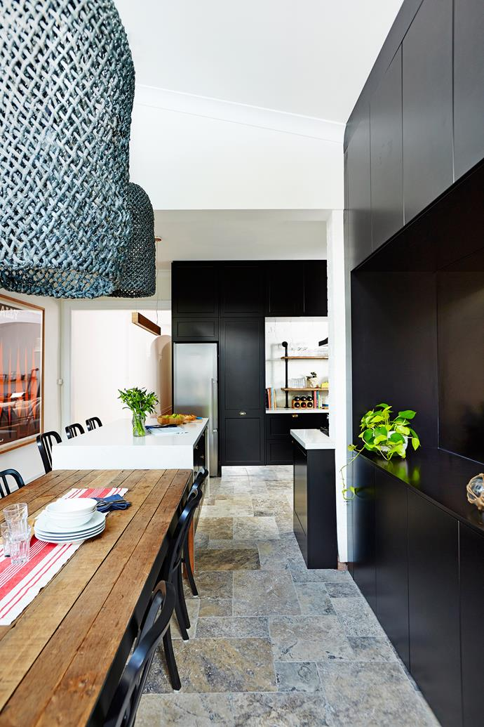 "David and Angie sourced travertine tiles from [Exclusive Tiles](http://www.exclusivetiles.com.au/?utm_campaign=supplier/|target=""_blank"") and laid them in a traditional French pattern, using three sizes arranged randomly. The matt-black cabinetry features vacuum-sealed [Calais](http://www.calaiskitchens.com.au/?utm_campaign=supplier/
