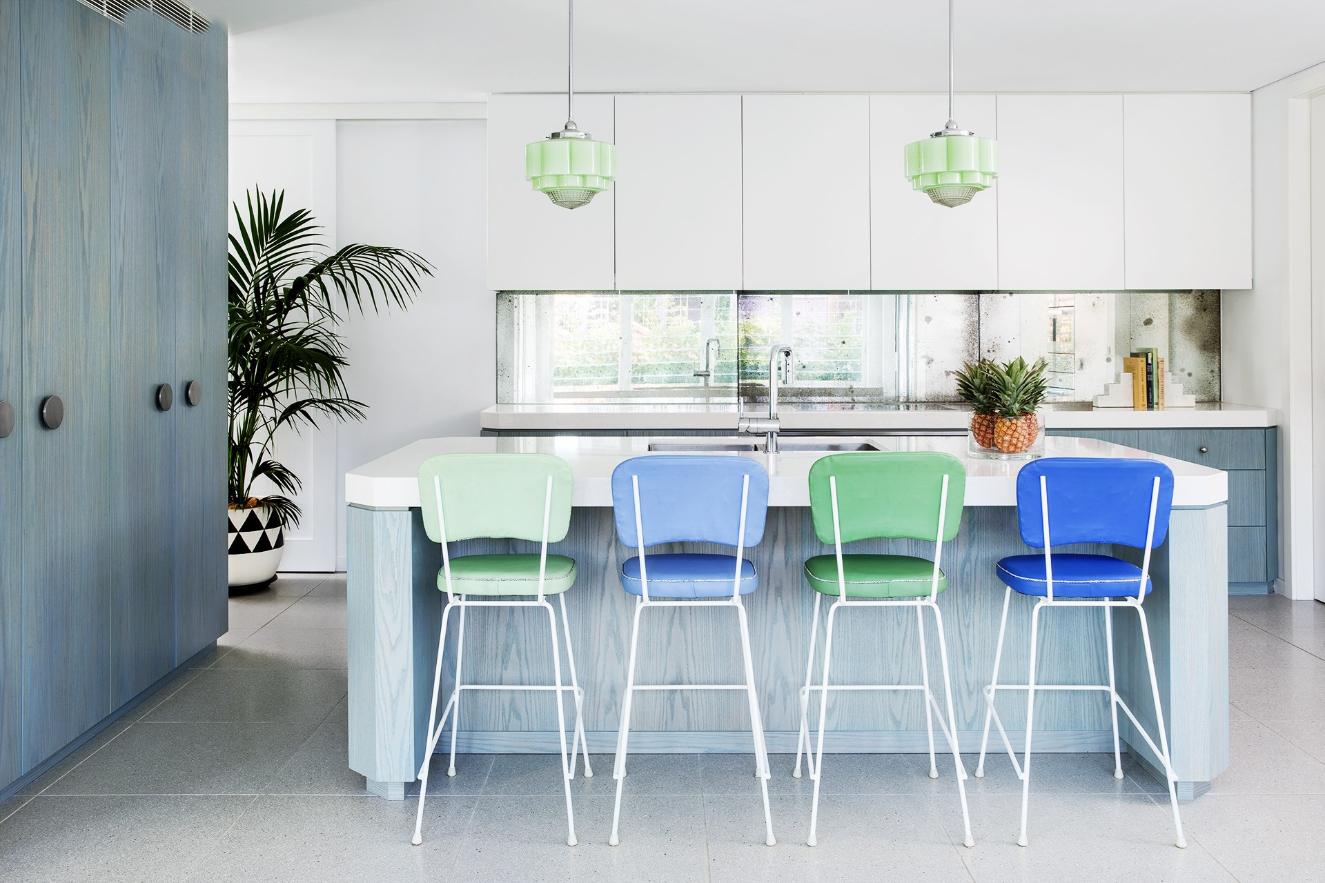 """This large family kitchen has a Miami deco vibe thanks to interior designer [Stacey Kouros](http://staceykourosdesign.com/?utm_campaign=supplier/
