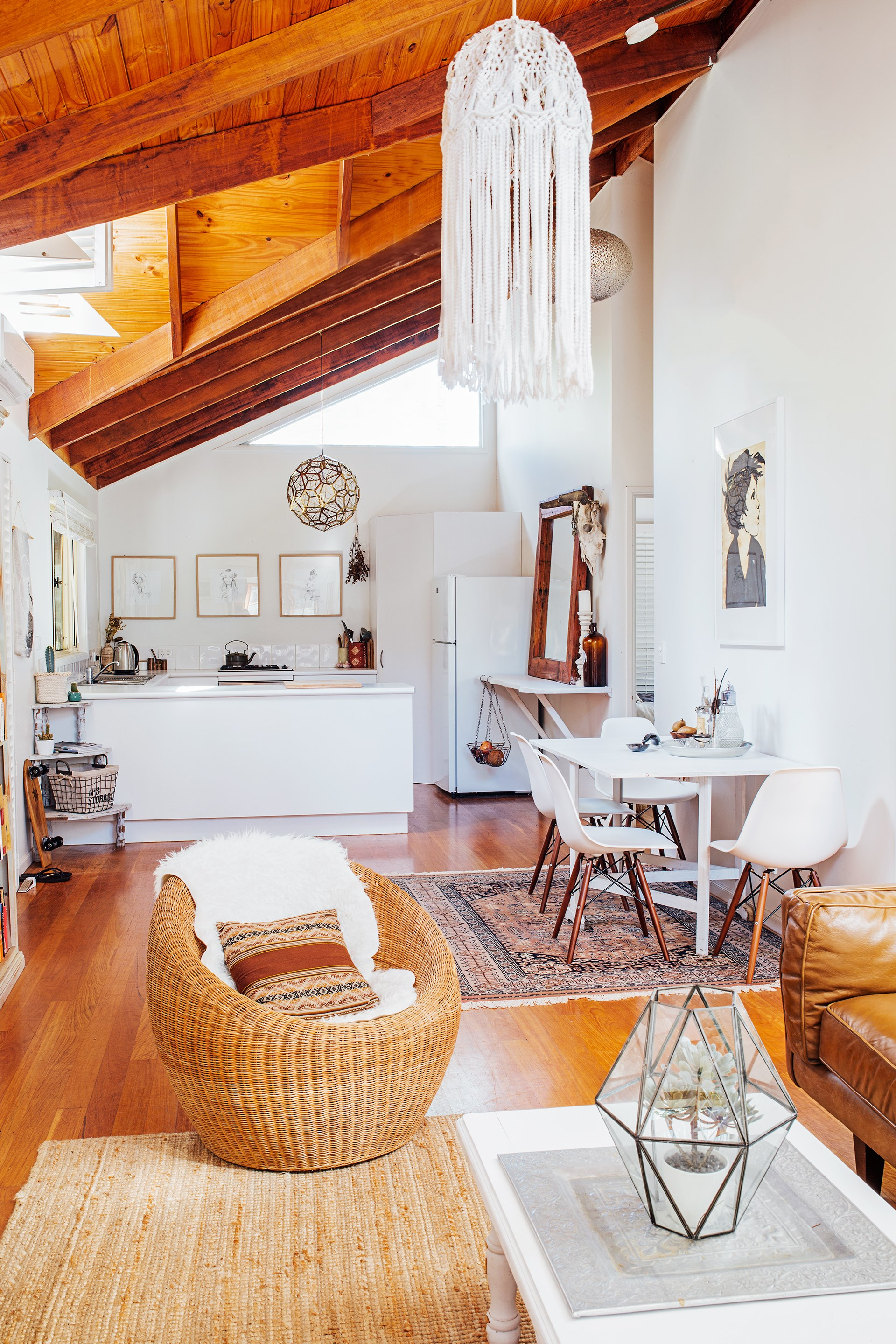 """Relaxed boho styling shines through in this jewellery designer's Byron Bay home. See more of this [treasure-filled weatherboard](http://www.homestolove.com.au/gallery-chris-and-celestes-treasure-filled-house-2266