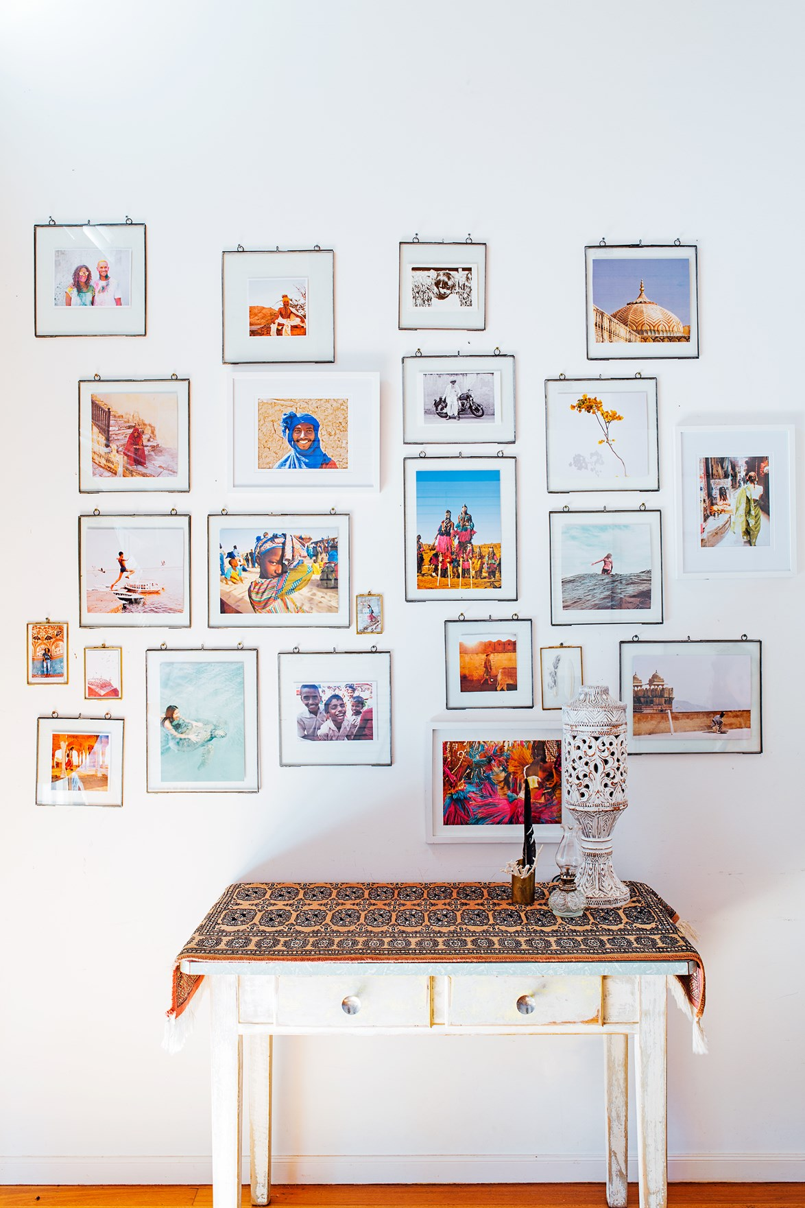 Vibrant travel photos are on display in this treasure-filled home. The simple brass frames allow the snaps, taken in Mali, India and Vanuatu, to shine. You could do the same with family photos.