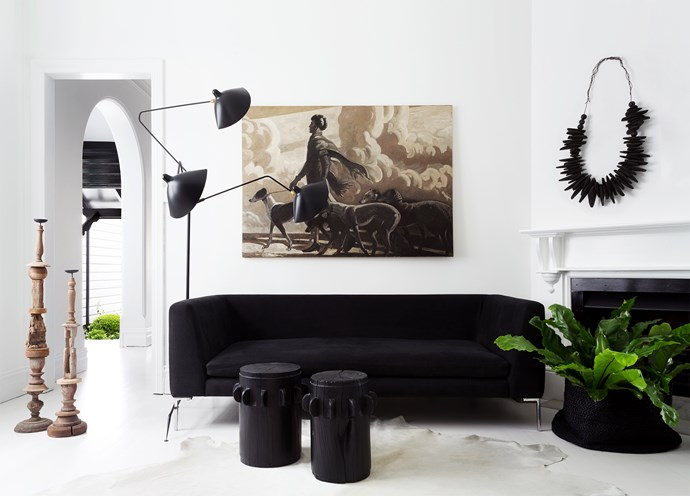 "In the formal living room, a Serge Mouille Three-Arm Standing Lamp from [Cult](http://www.cultdesign.com.au/|target=""_blank"") presides over a custom-made sofa in [Westbury Textiles](http://www.westburytextiles.com/