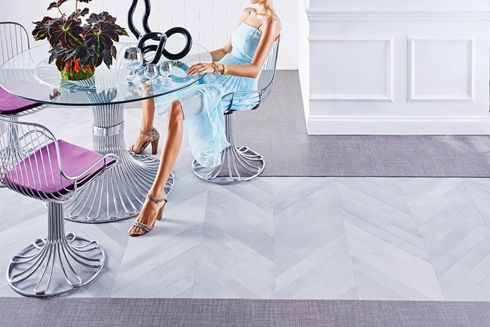 """Vary tiles to create zones, border a room or make a 'rug'.   Mate chevron porcelain tiles in Fumo from [Di Lorenzo](http://www.dilorenzo.com.au/?utm_campaign=supplier/ target=""""_blank""""). Laneway vinyl tiles in Black Weave (border) from [Carpet Court](http://www.carpetcourt.com.au/?utm_campaign=supplier/ target=""""_blank""""). Italian 1970s chrome and glass dining suite from [Our Space Interiors](http://www.ourspaceinteriors.com/?utm_campaign=supplier/ target=""""_blank"""")."""
