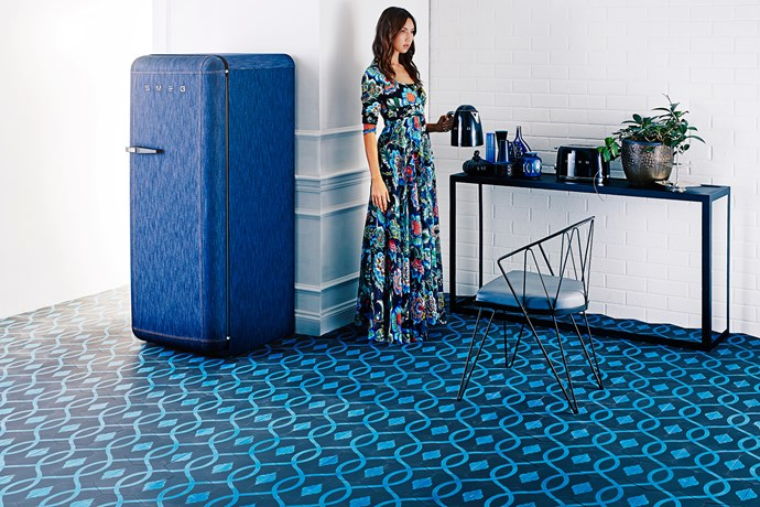 """A swathe of patterned floor tiles can become the hero piece in any room of the house.   Cement hexagon tiles in Vivid Blue/Black from [Teranova](http://www.teranova.com.au/?utm_campaign=supplier/ target=""""_blank""""). Fab28 fridge in Denim from [Smeg](http://www.smeg.com.au/?utm_campaign=supplier/ target=""""_blank""""). New York console and Spargo metal chair from [MCM House](http://www.mcmhouse.com/?utm_campaign=supplier/ target=""""_blank"""")."""