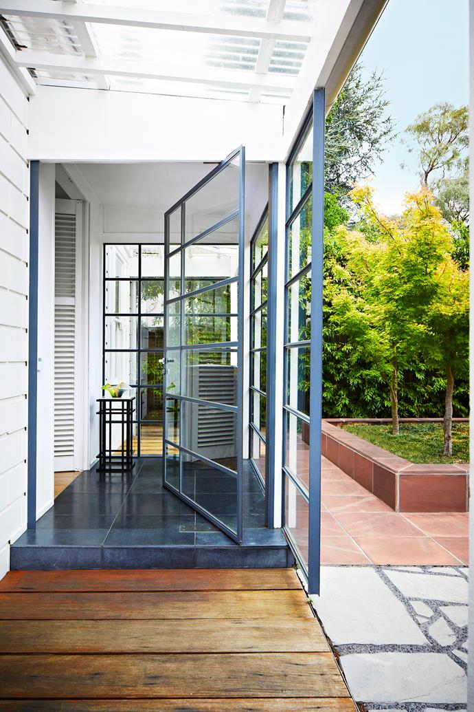 A glass-walled vestibule has been added to the Victorian-era facade to provide views to the front garden. Both the front garden's design and the vestibule are loosely connected to the idea of a Japanese bento box.