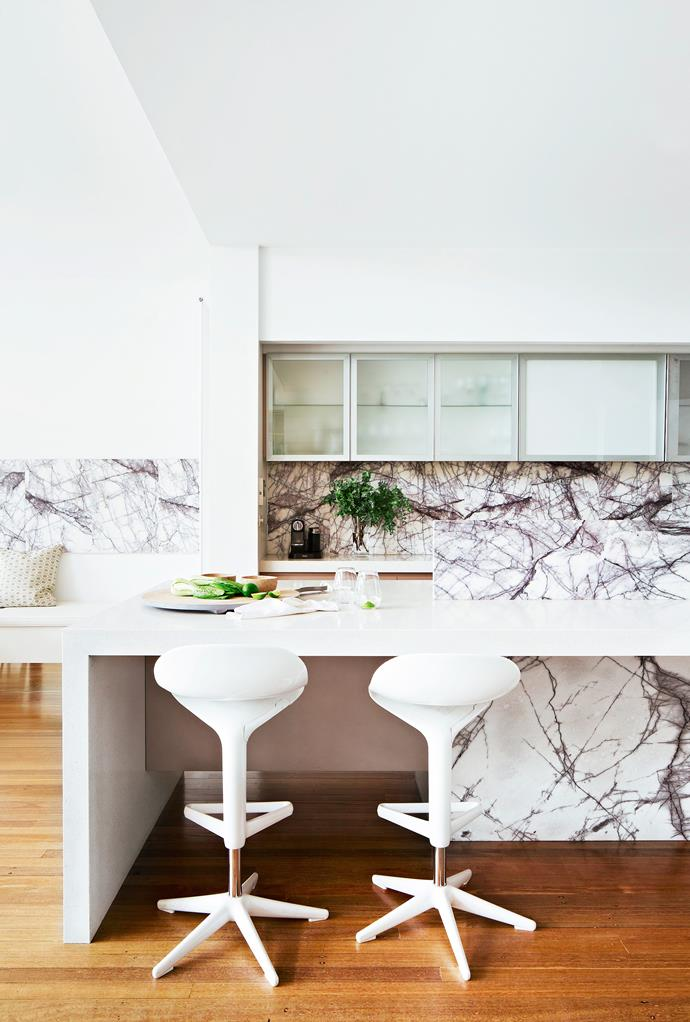"""Deeply veined Turkish marble energises the mostly white kitchen scheme. The built-in banquette, with storage and mirrored kickboard, is by owner Jon's company [Newline Design](http://www.newlinedesign.com.au/?utm_campaign=supplier/