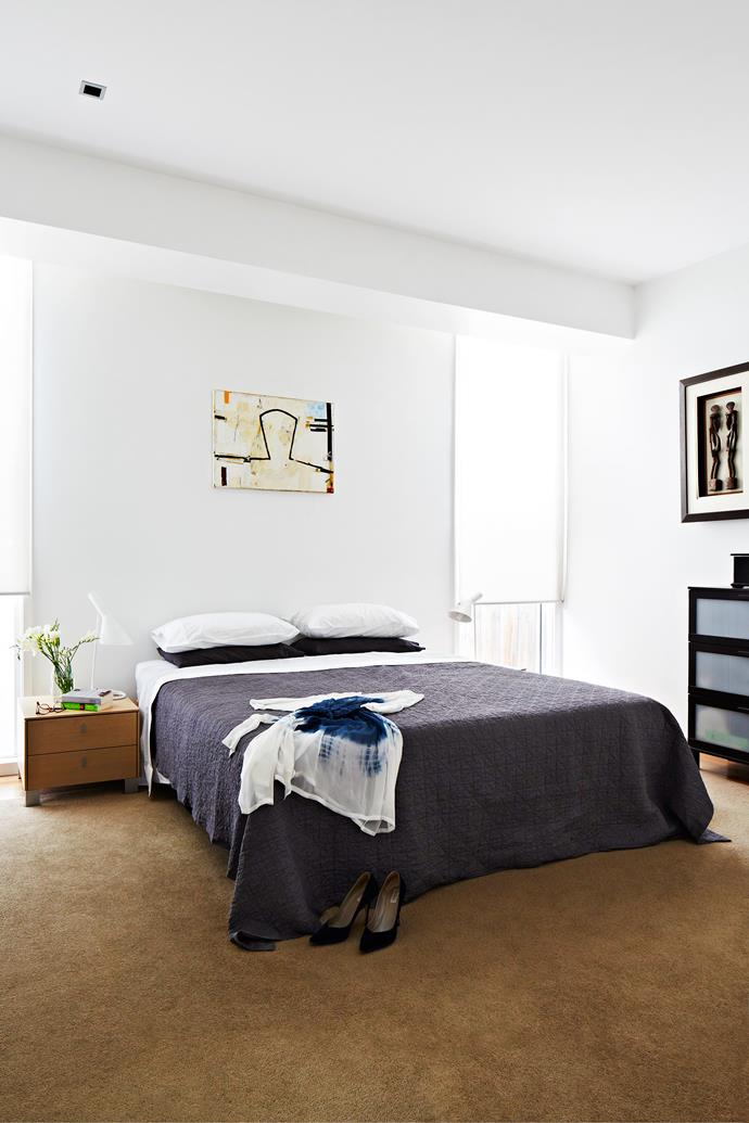 """Jon designed the main bedroom so light pours in on either side of the bed and the walk-in wardrobe to the right muffles sound from the adjacent living area. **Quilt** from [West Elm](http://www.westelm.com.au/?utm_campaign=supplier/