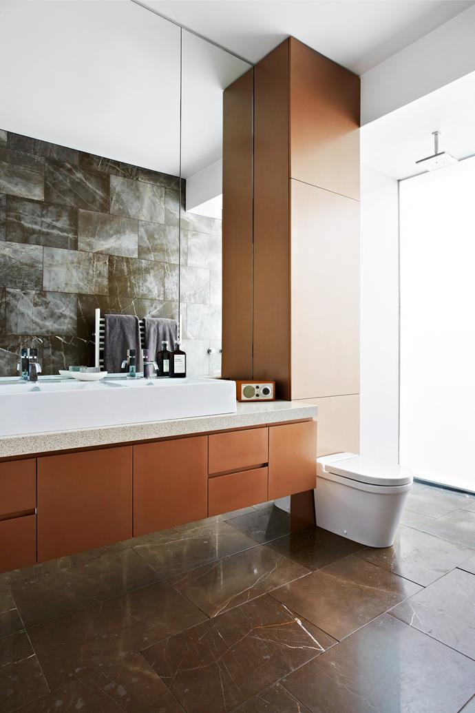 """In the main bedroom ensuite, a dappled [Caesarstone](http://www.caesarstone.com.au/?utm_campaign=supplier/