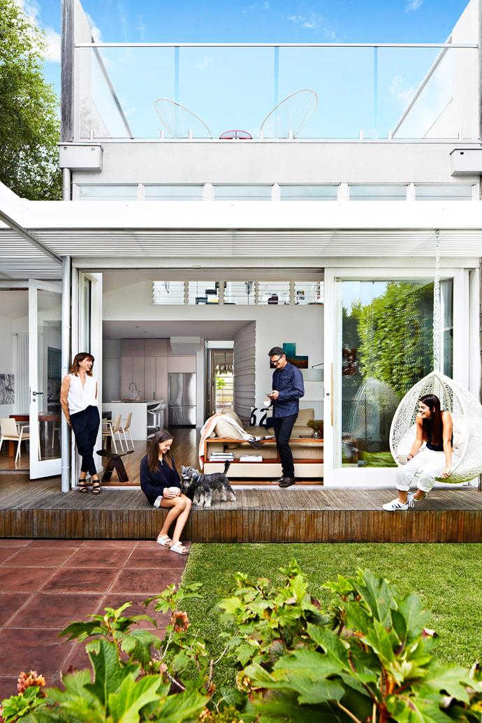 """The rear extension suits everyone, says owner Jon, here with his wife Vanessa, daughters Ava (left) and Jemima and miniature schnauzers Daisy and Murphy. Egg rattan **hanging chair** from [Milan Direct](http://www.milandirect.com.au/?utm_campaign=supplier/