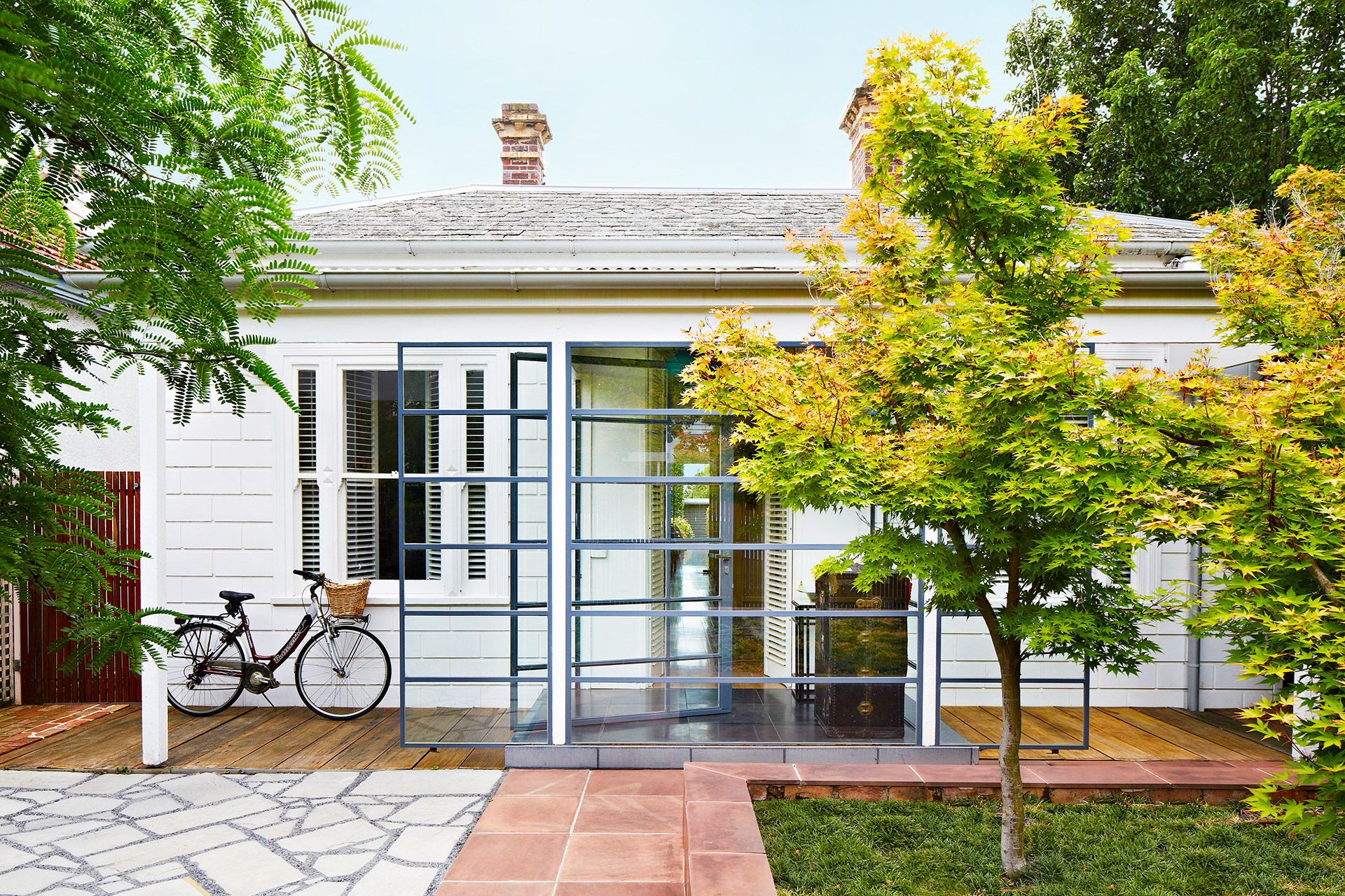 A glass-walled entryway is an intriguing addition to this Victorian-era weatherboard. See more of this [surprisingly renovation of a Melbourne home](http://www.homestolove.com.au/jon-and-vanessas-surprising-family-home-with-bonus-office-2271). *Photography: Armelle Habib | Story: Australian House & Garden*